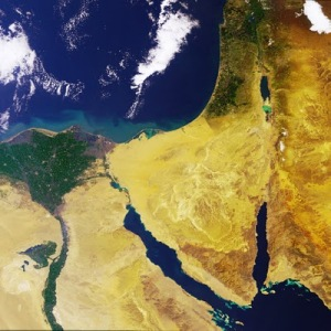 The fertile green territory of Egypt's Nile Delta provides a notable contrast to the bare desert of the Sinai Peninsula